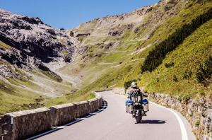 Famous Passo Dello Stelvio Road in Swiss - Italy border. Favourite place for all bike riders. Alone biker on the top.